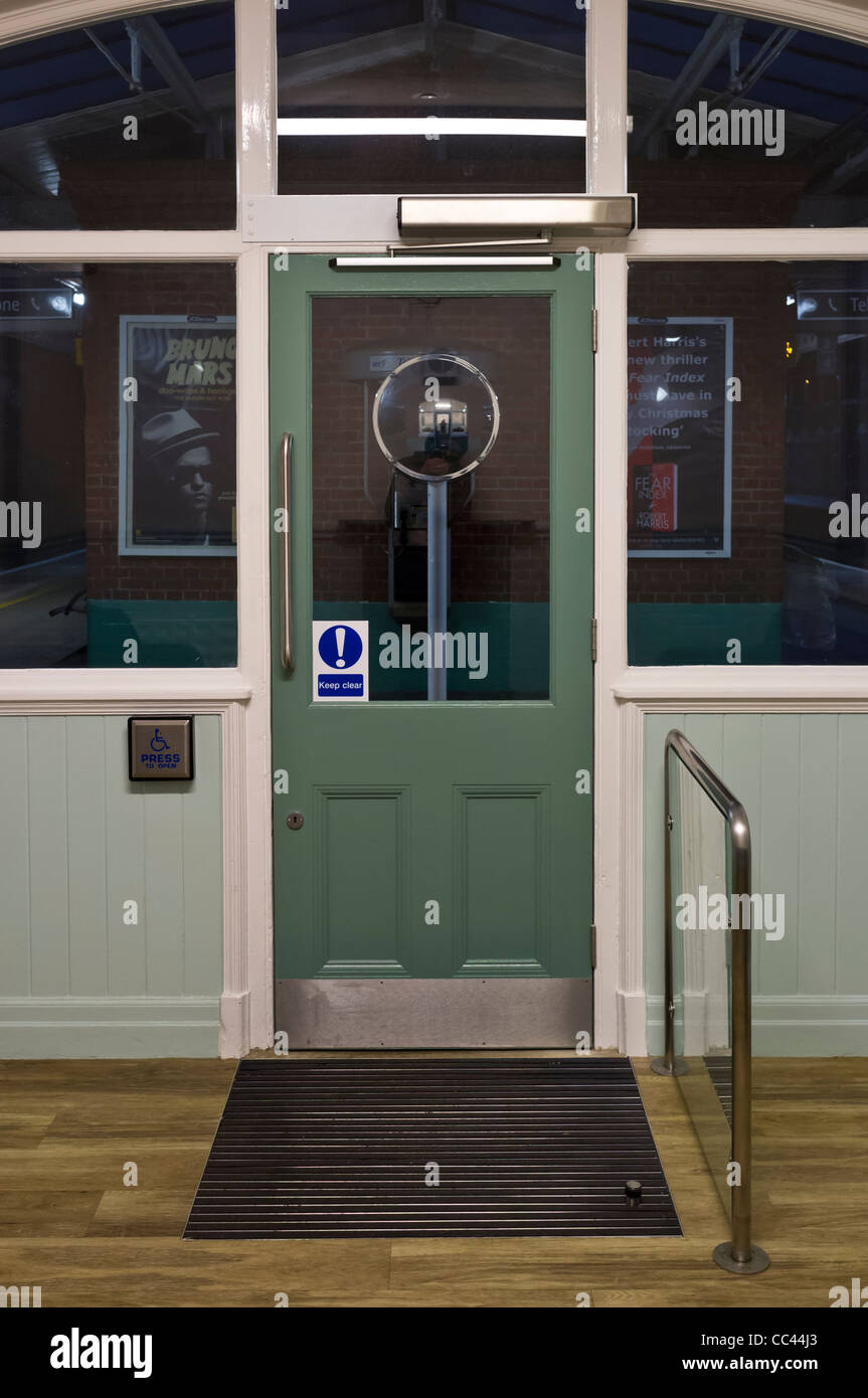 Station waiting room door with automatic opener and closer. - Stock Image