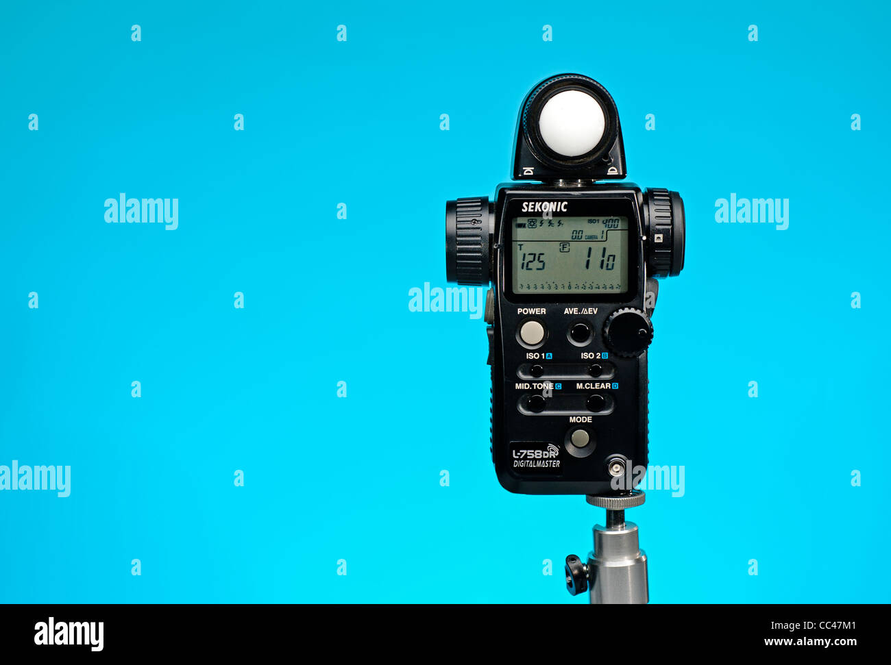 Sekonic L-758 Digital Master light meter vivid blue background with room for copy - Stock Image
