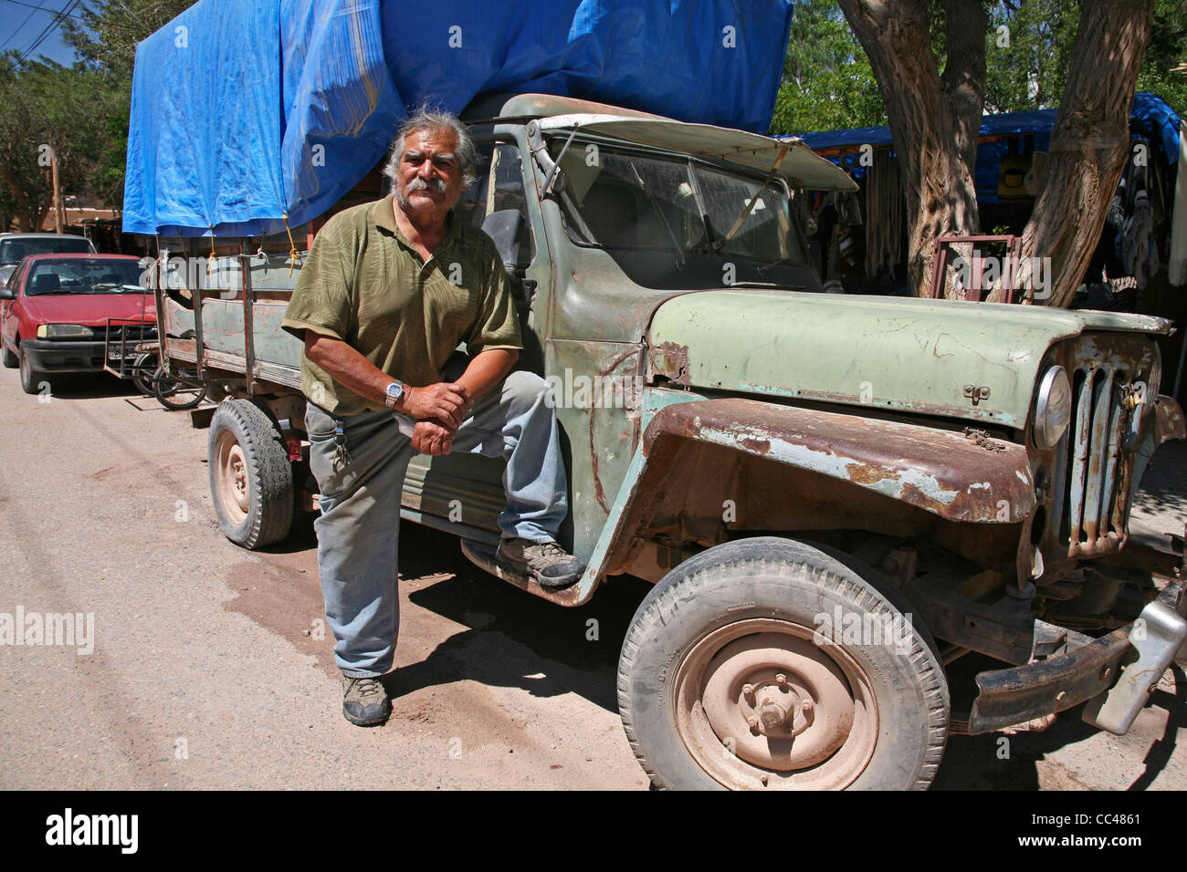 Driver And 50 Year Old Truck In Tilcara, Jujuy Province, Argentina   Stock  Image