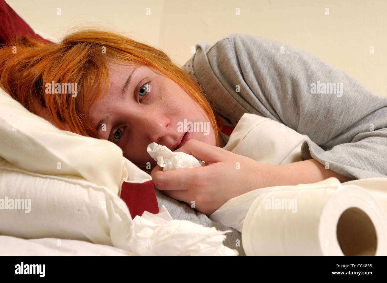 Young Women In Bed Unwell. - Stock Image