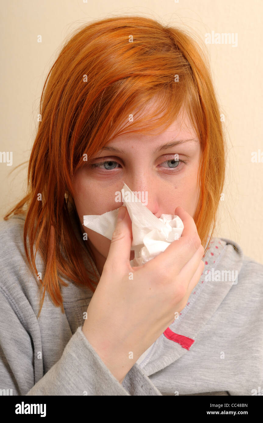 Young Women  Unwell.Suffering with cold. - Stock Image