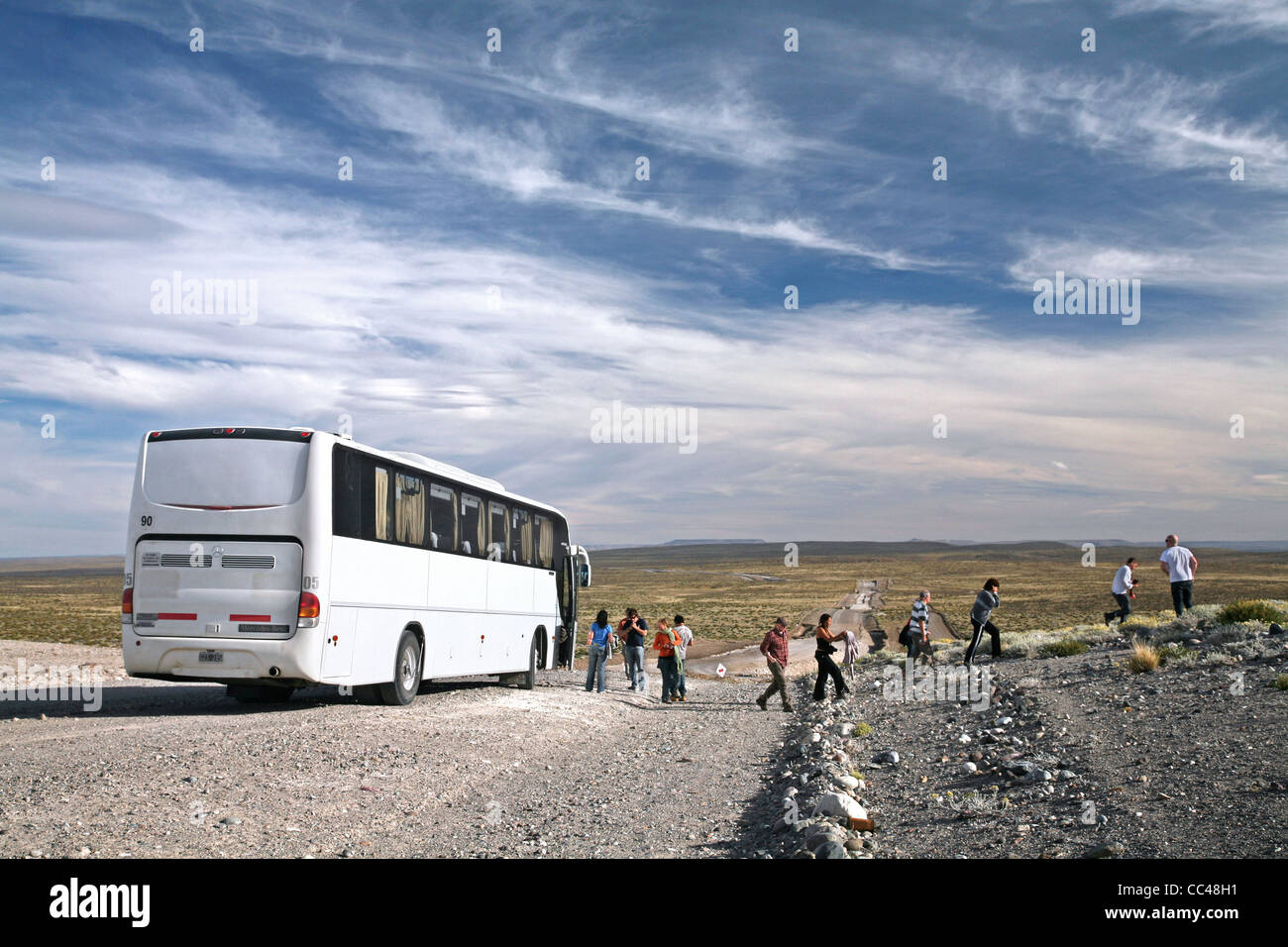 Tourists and touring car on the Route 40 in Patagonia, Argentina - Stock Image