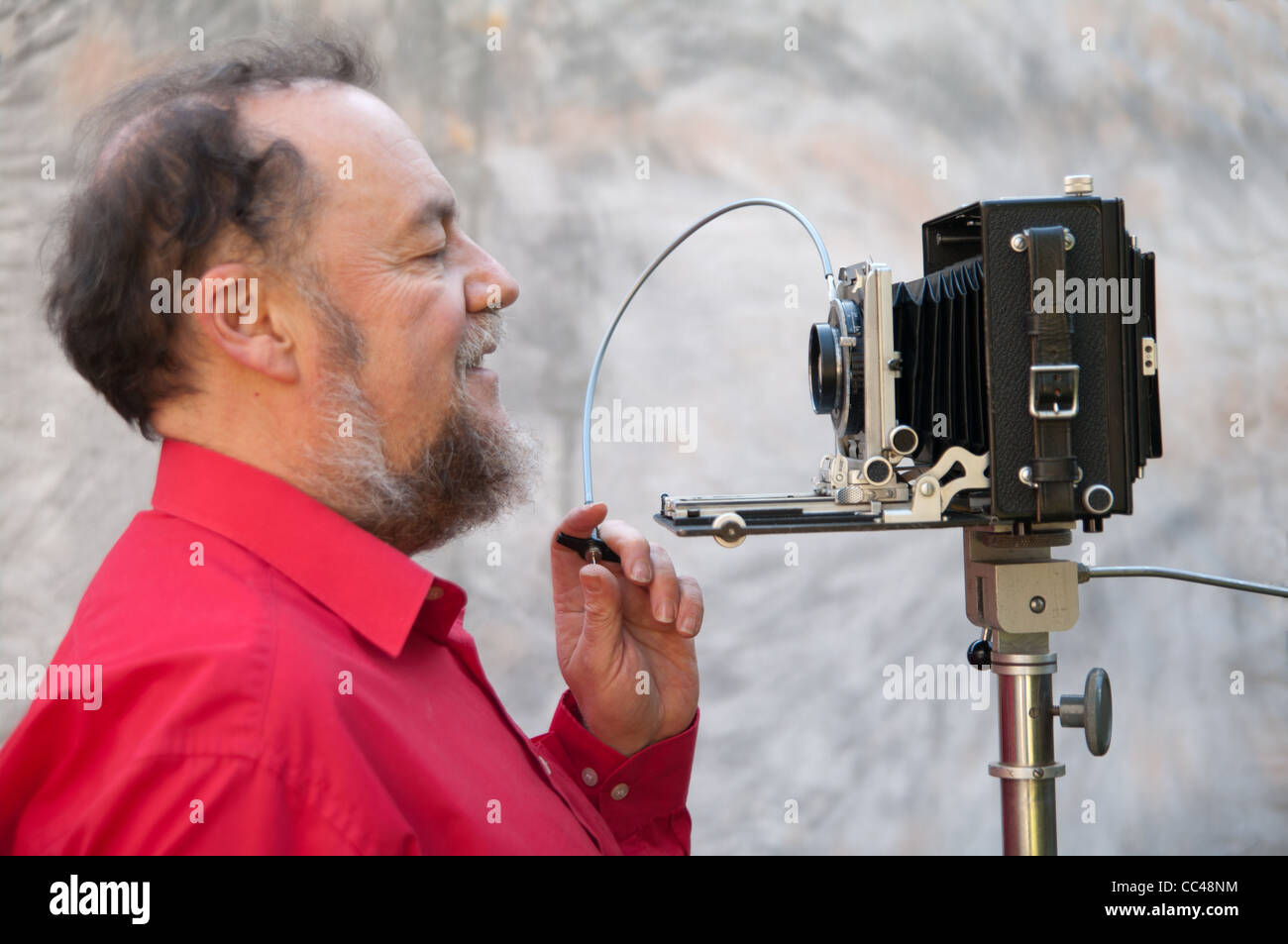 A photographer attempts to take a self portrait with a large format camera - Stock Image