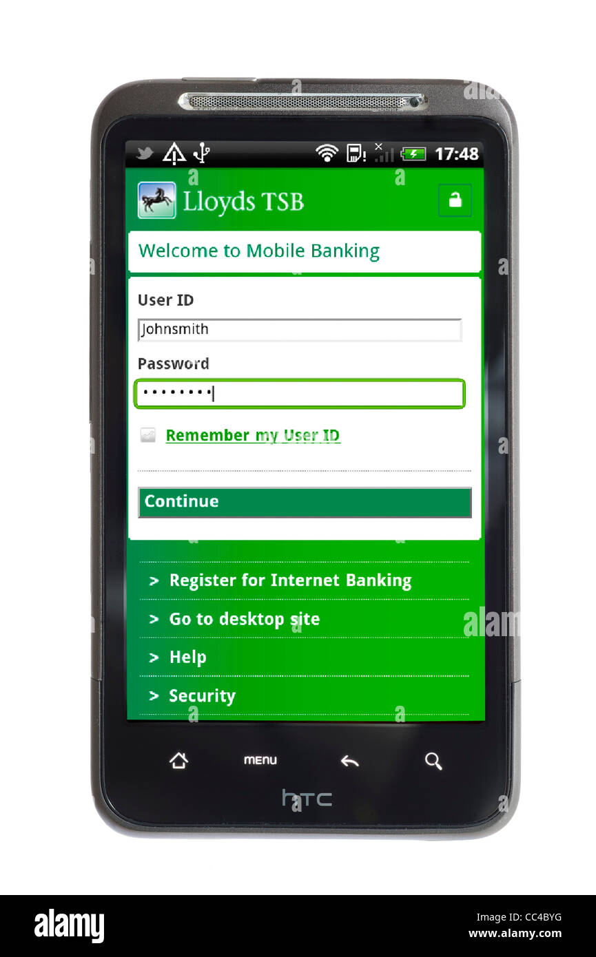 Logging on to mobile banking with the Lloyds TSB app on an HTC smartphone - Stock Image