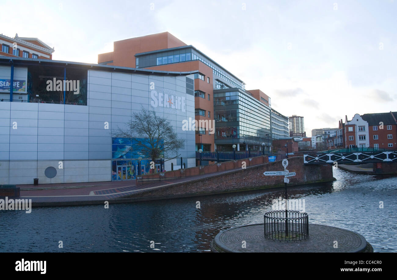 Birmingham West Midlands Old Turn Junction on Birmingham Canals Navigation with National Sea Life Centre canalside - Stock Image