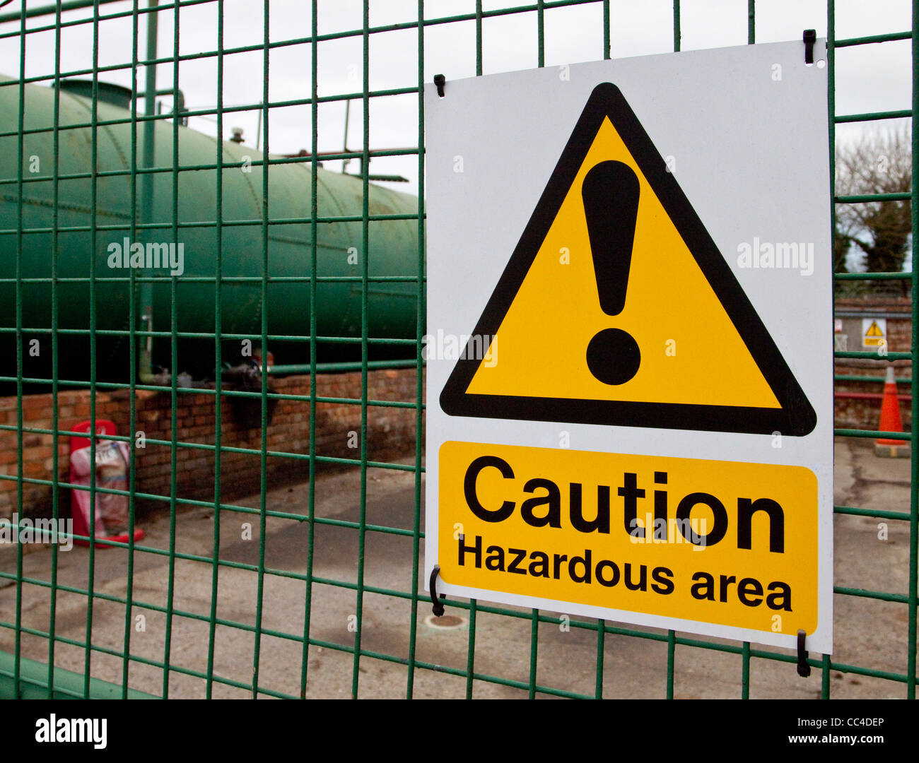 Hazardous Area Caution Sign at oil storage oil depot. Health and Safety Sign - Stock Image