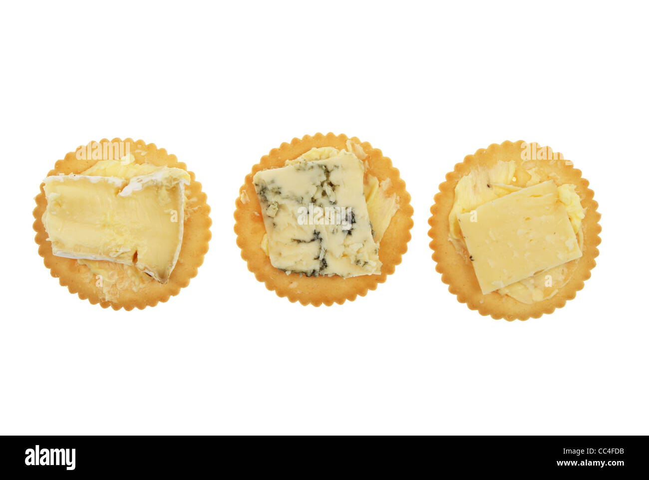 Selection of cheese and biscuits isolated against white - Stock Image
