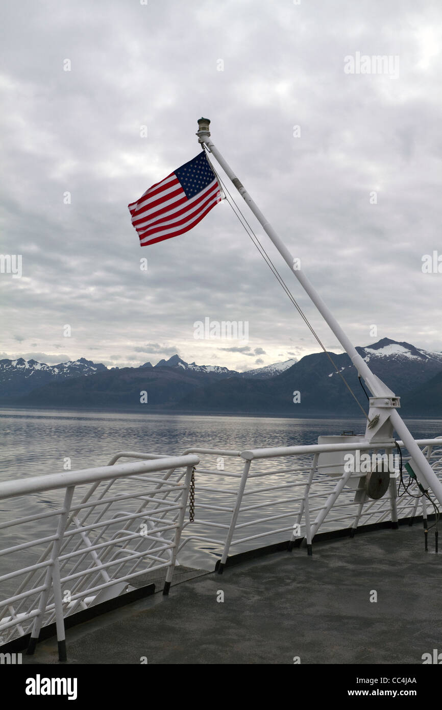 USA flag on Taku Ferry along the Inside Passage between Kake and Sitka, Alaska - Stock Image