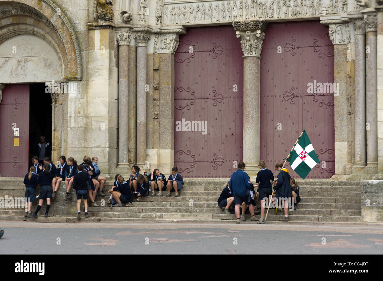 French girl guides outside Vézelay Abbey (Basilique Sainte-Marie-Madeleine), Burgundy, France. Stock Photo