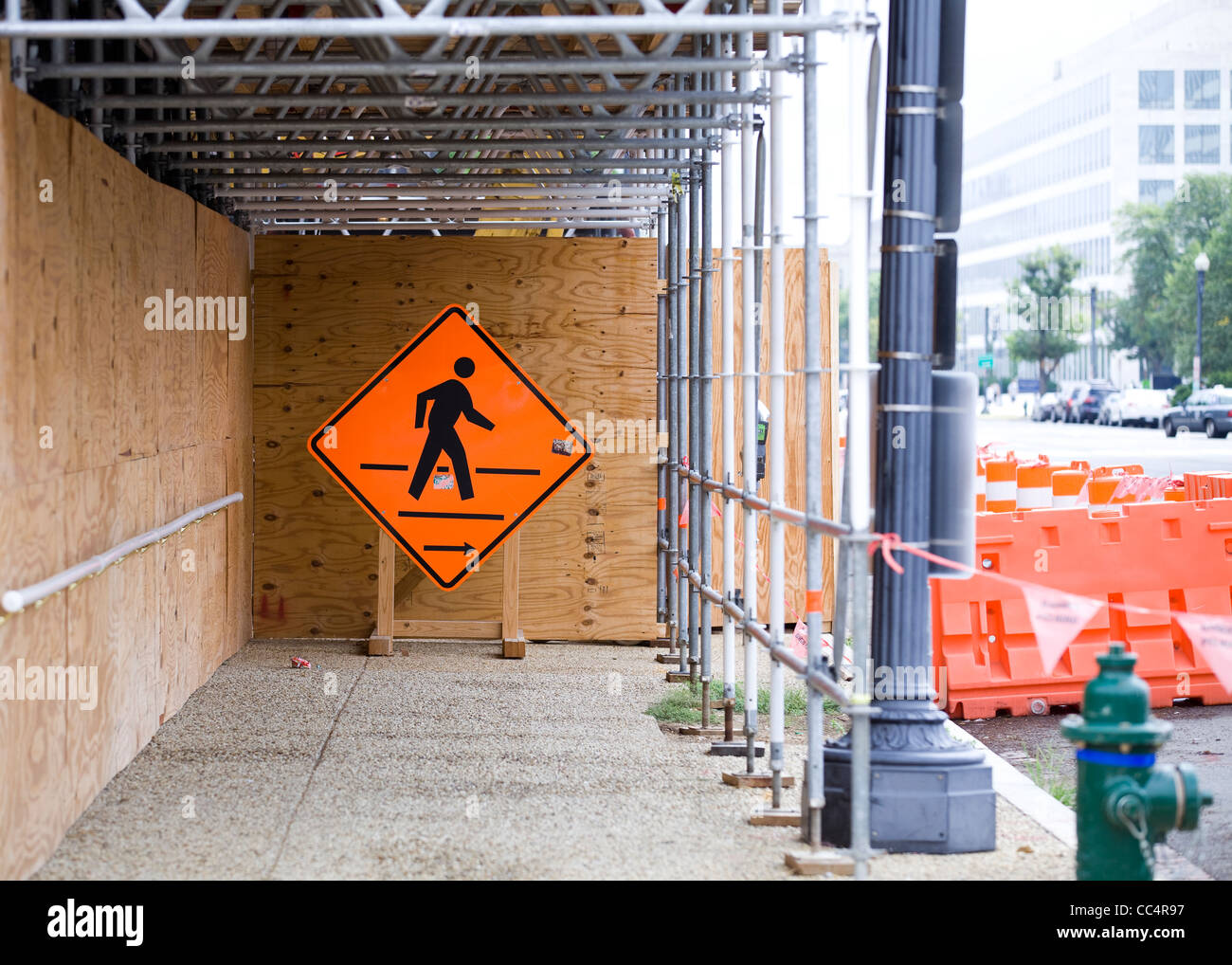Pedestrian crossing sign under construction scaffold - Stock Image