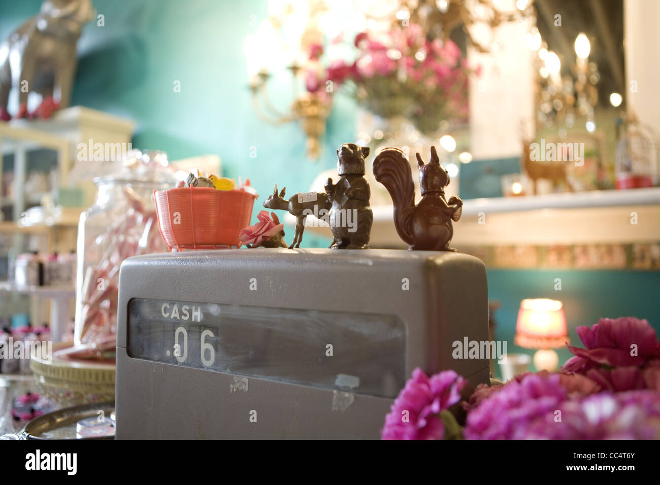 Plastic Figurines on an Old Cash Register - Stock Image