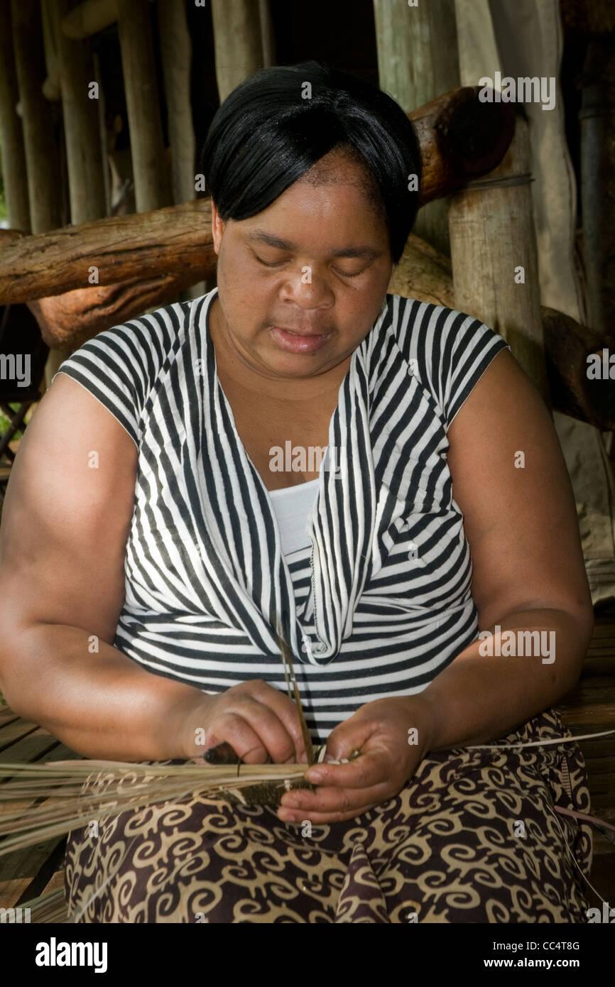 Africa Botswana Tuba Tree-Native woman weaving basket - Stock Image