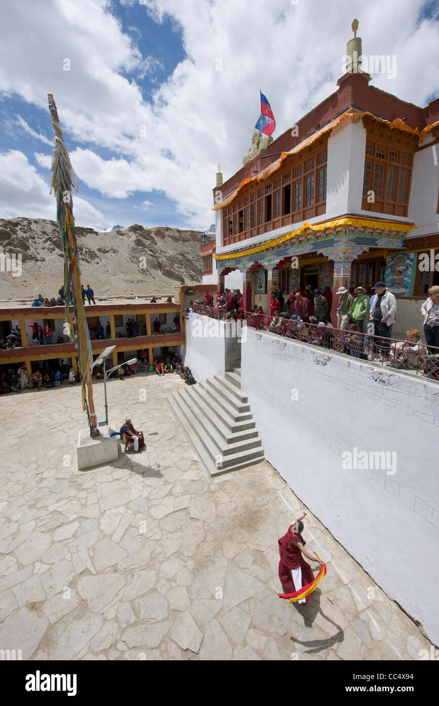 Monks and Western tourists watching monks dancing at the Korzok Gompa, Korzok Gustor festival, Lake Tsomoriri, (Ladakh) - Stock Image