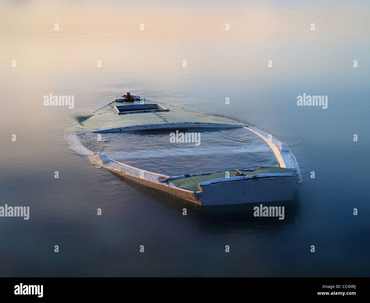 sinking boat in the fog - Stock Image