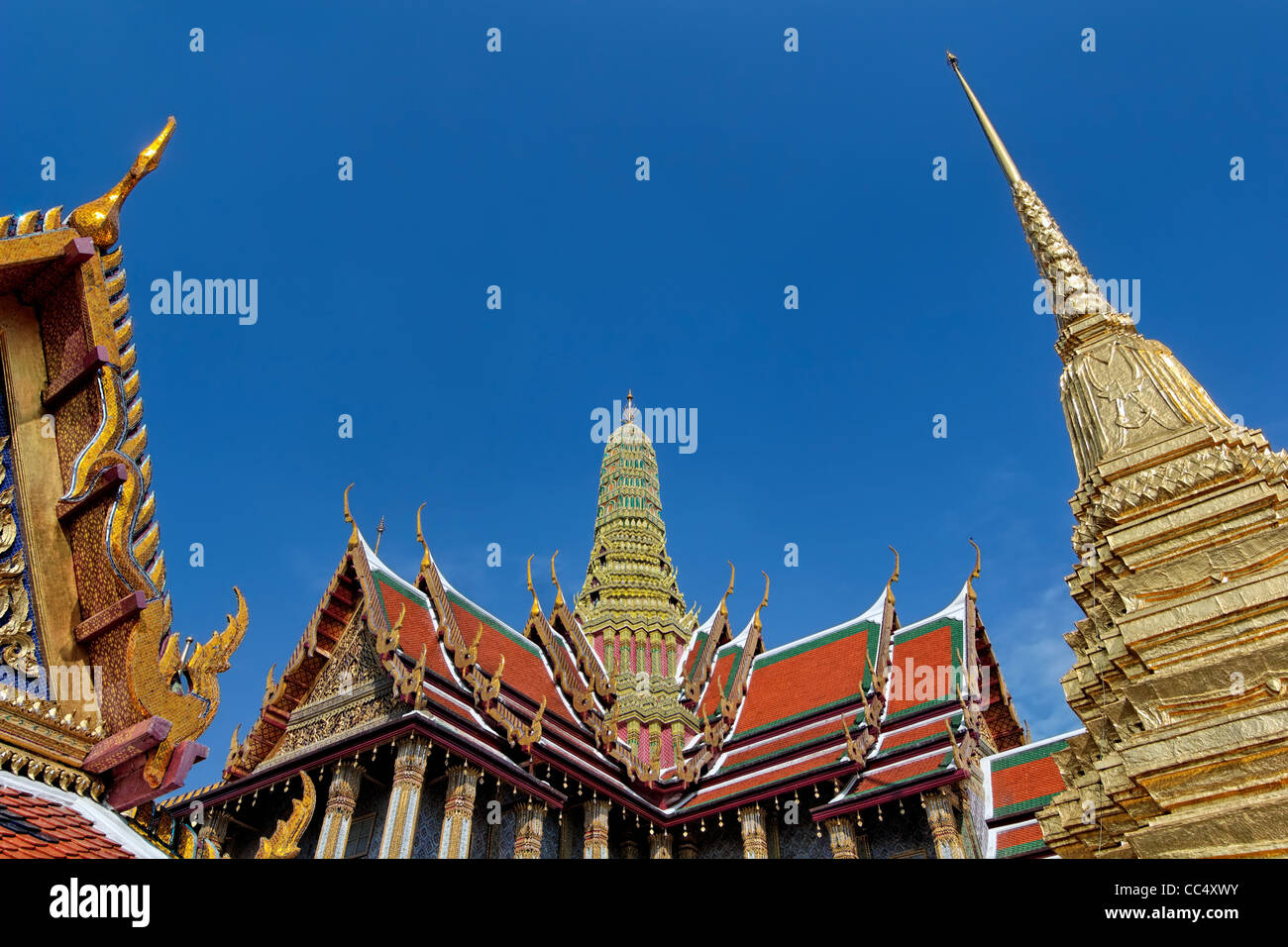 Temple of the Emerald Buddha (Wat Phra Kaew) is Thailand's most revered and holy temple & its biggest tourist - Stock Image