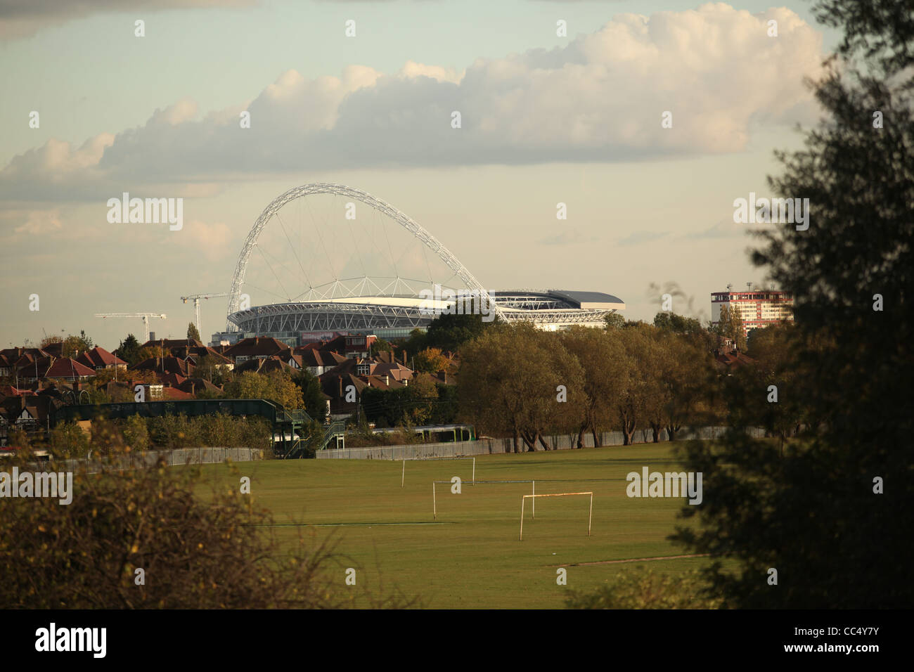 A view of Wembley Stadium with football pitches in foreground - Stock Image