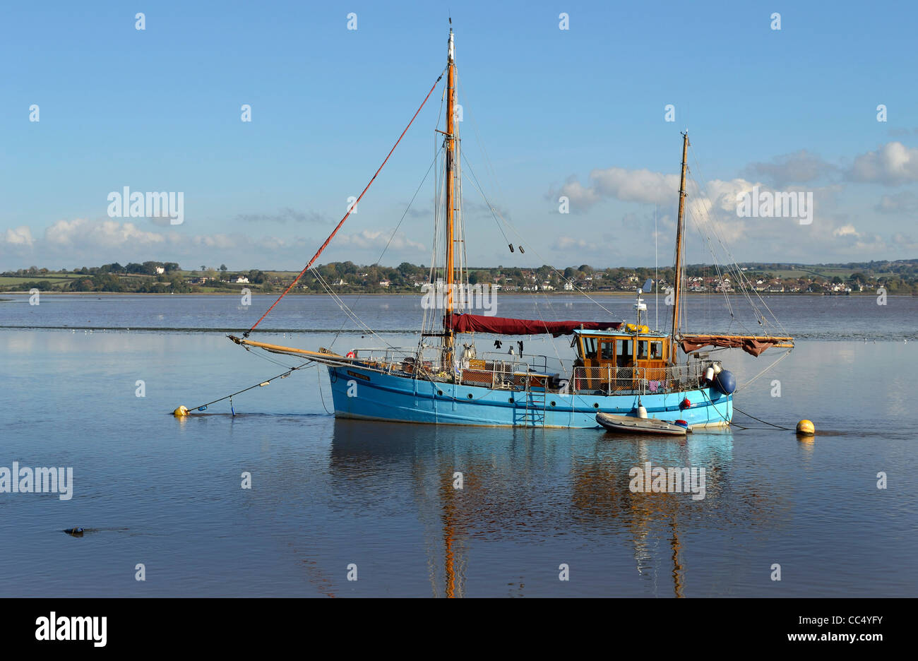 Classic twin masted sailing ship moored on the tidal River Exe below Topsham near Exeter below the Exeter ship canal - Stock Image