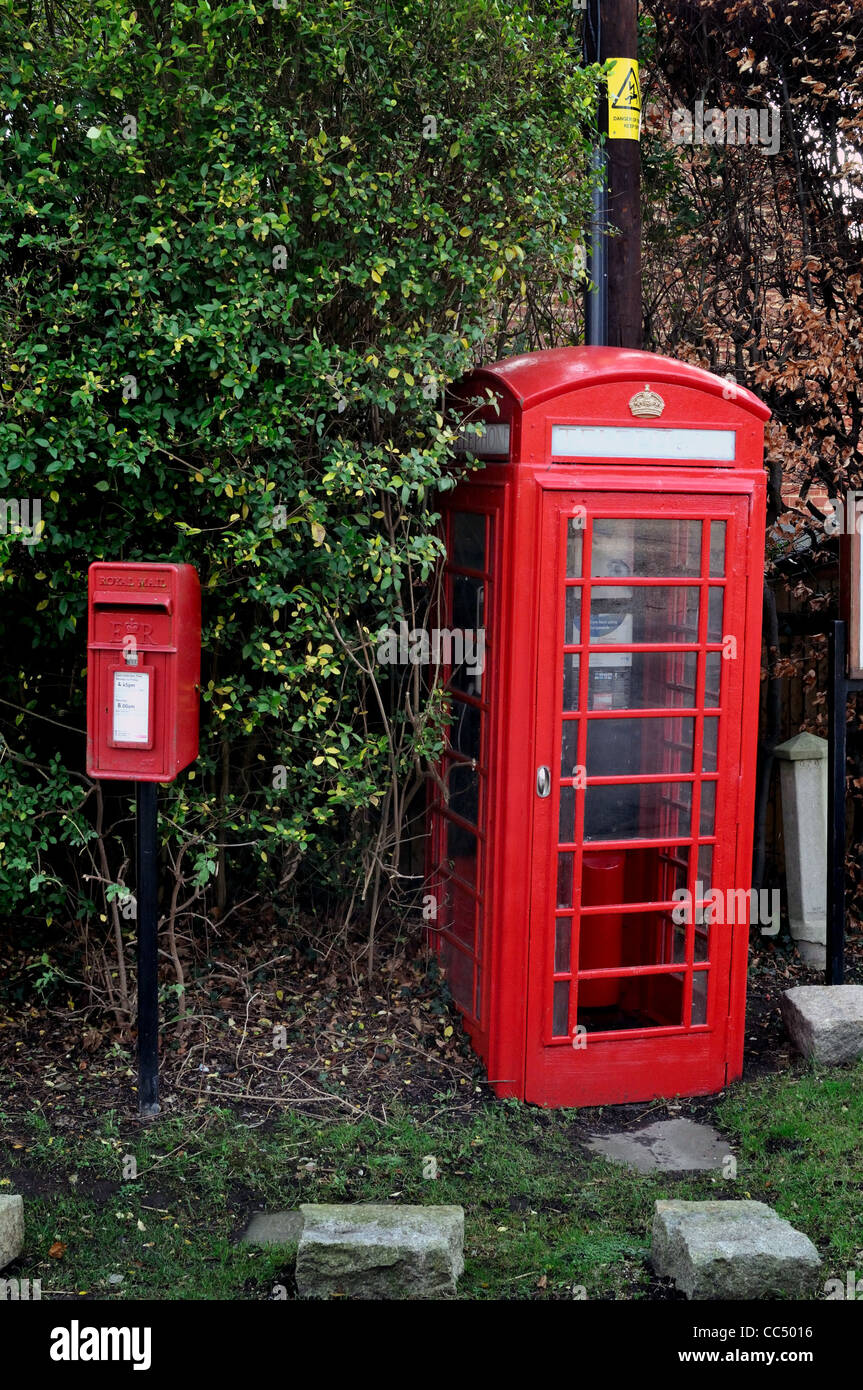 British traditional red telephone box and post box  in countryside - Stock Image