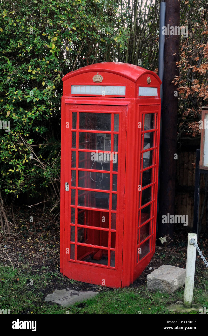 British traditional red telephone box in countryside - Stock Image