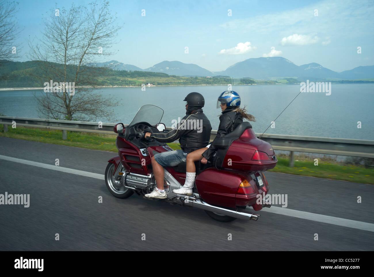 A red honda goldwing motorbike on the E50 road passing Liptovsky Mara (lake ) Slovakia - Stock Image