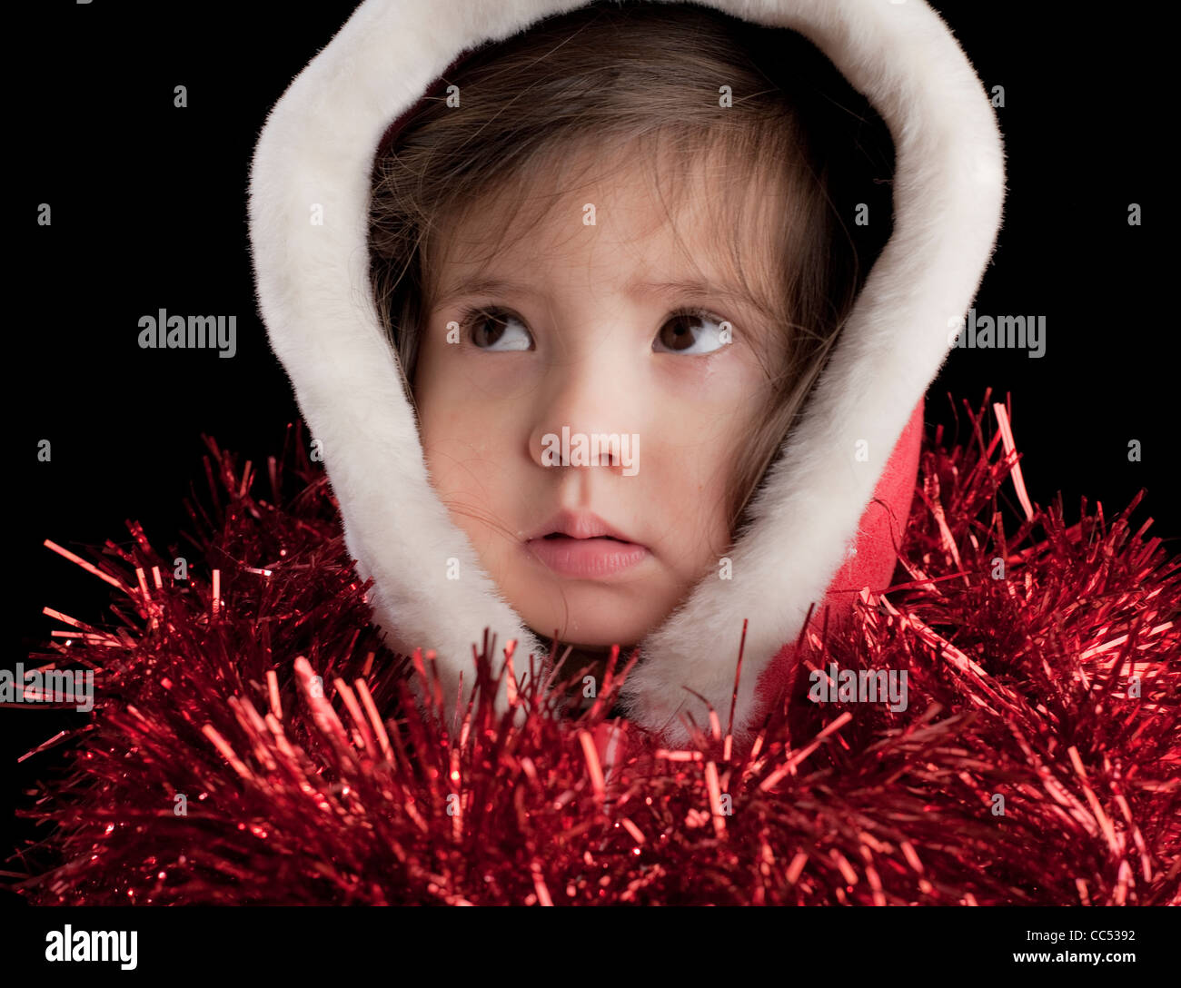 Girl wearing hood with tinsel - Stock Image