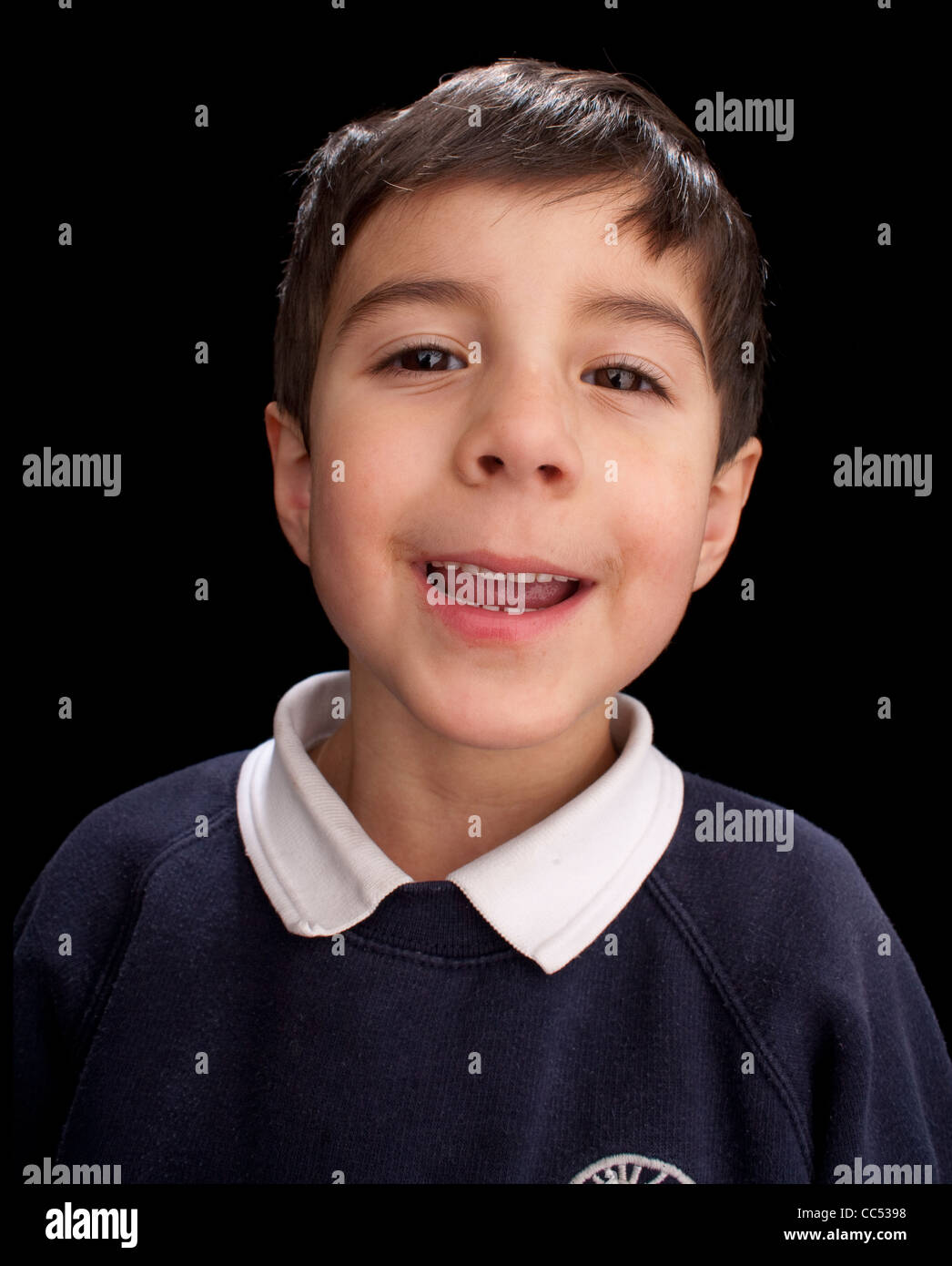 Boy smiling, studio shot - Stock Image
