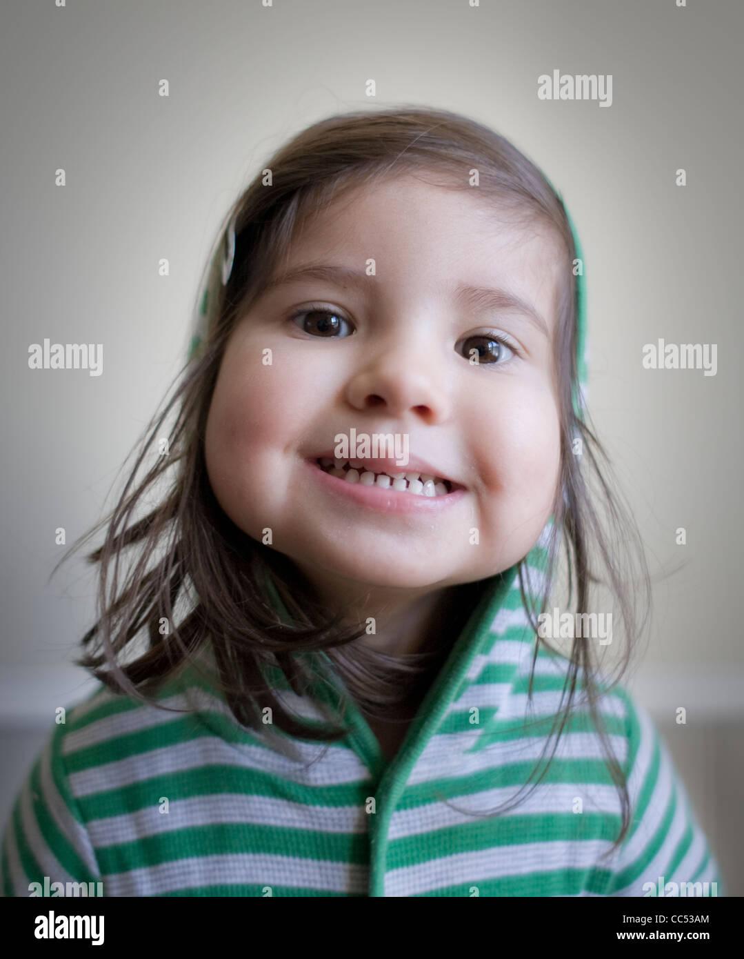 Girl wearing green striped top - Stock Image