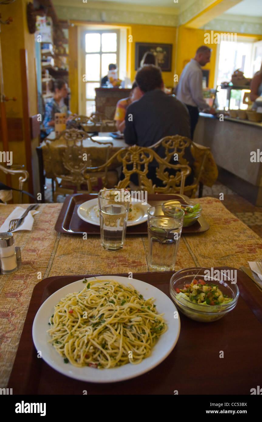 Spaghetti Aglio e olio dish at Edeni Vegan vegetarian restaurant at Batthyany ter square Buda district Budapest - Stock Image