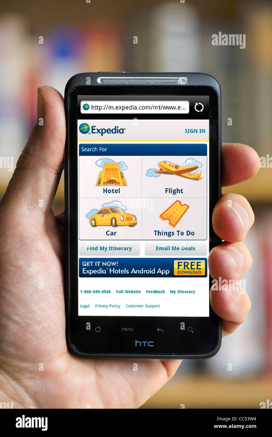 Browsing the Expedia travel website on an HTC smartphone - Stock Image