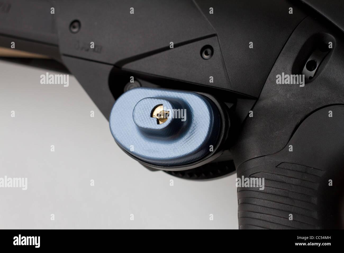 Close-up of shotgun with trigger lock - Stock Image