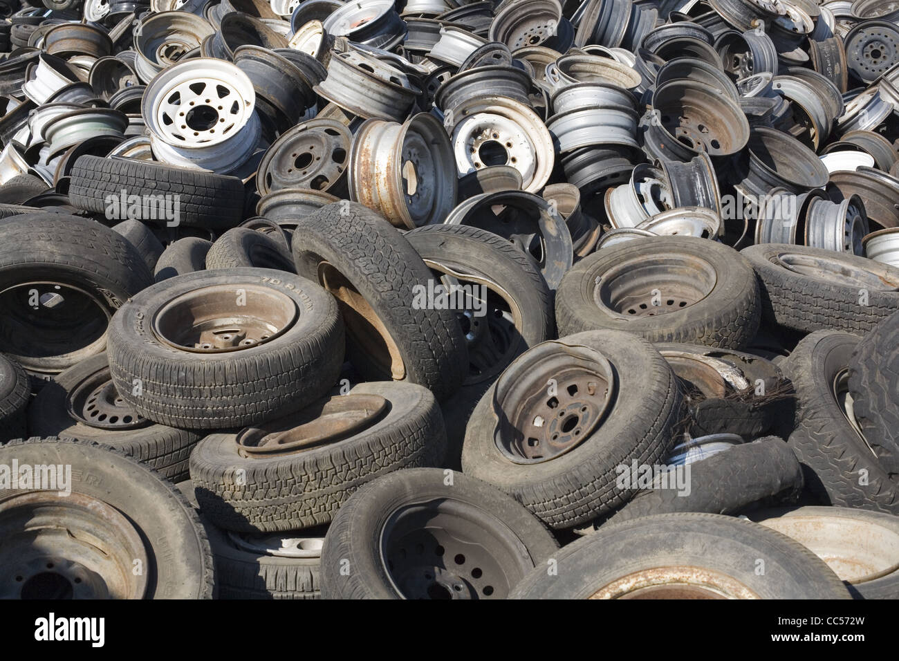 Junkyard Tires and Wheels - Stock Image