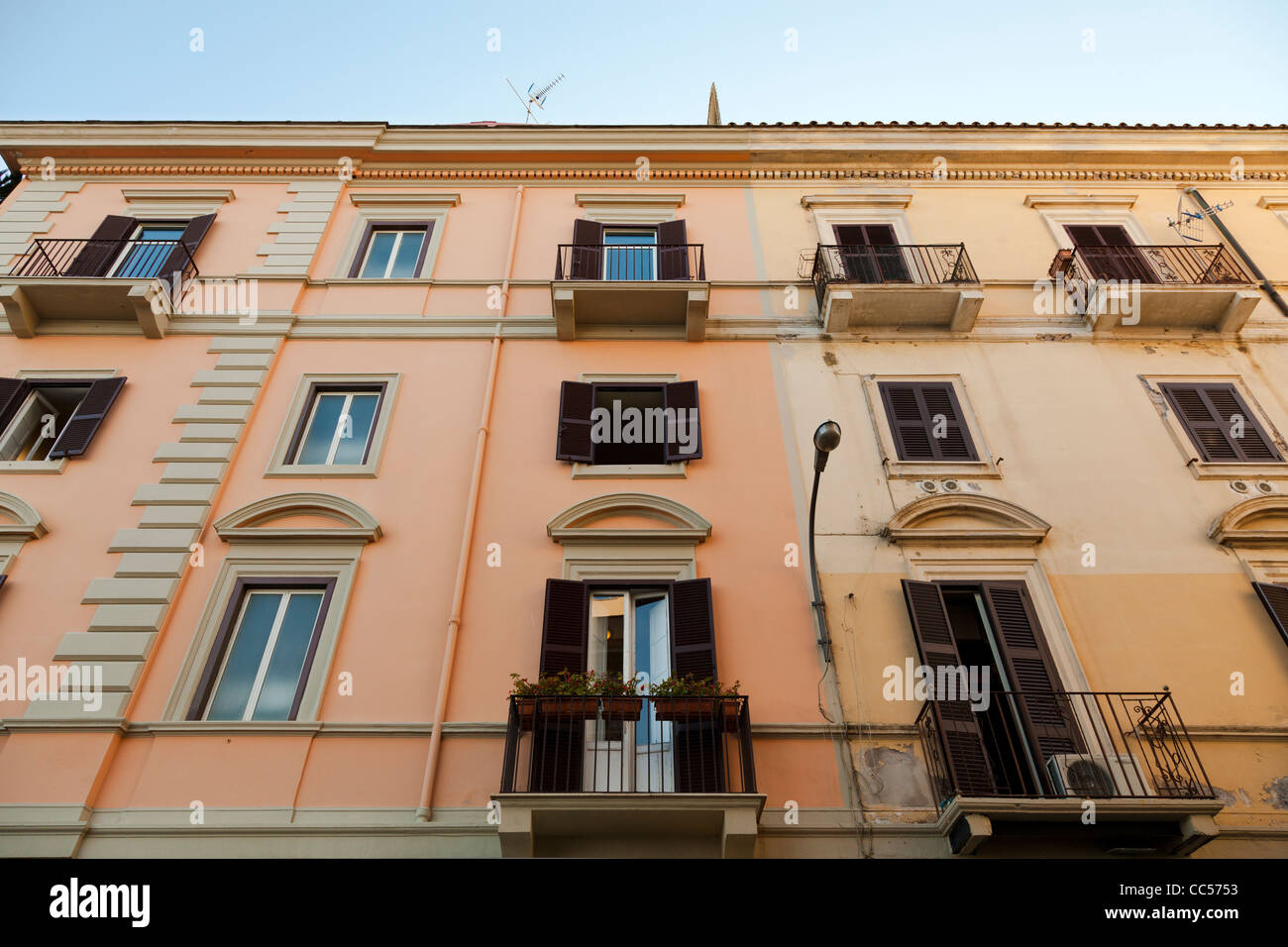 shuttered windows and balconies on italian houses at Anzio - Stock Image