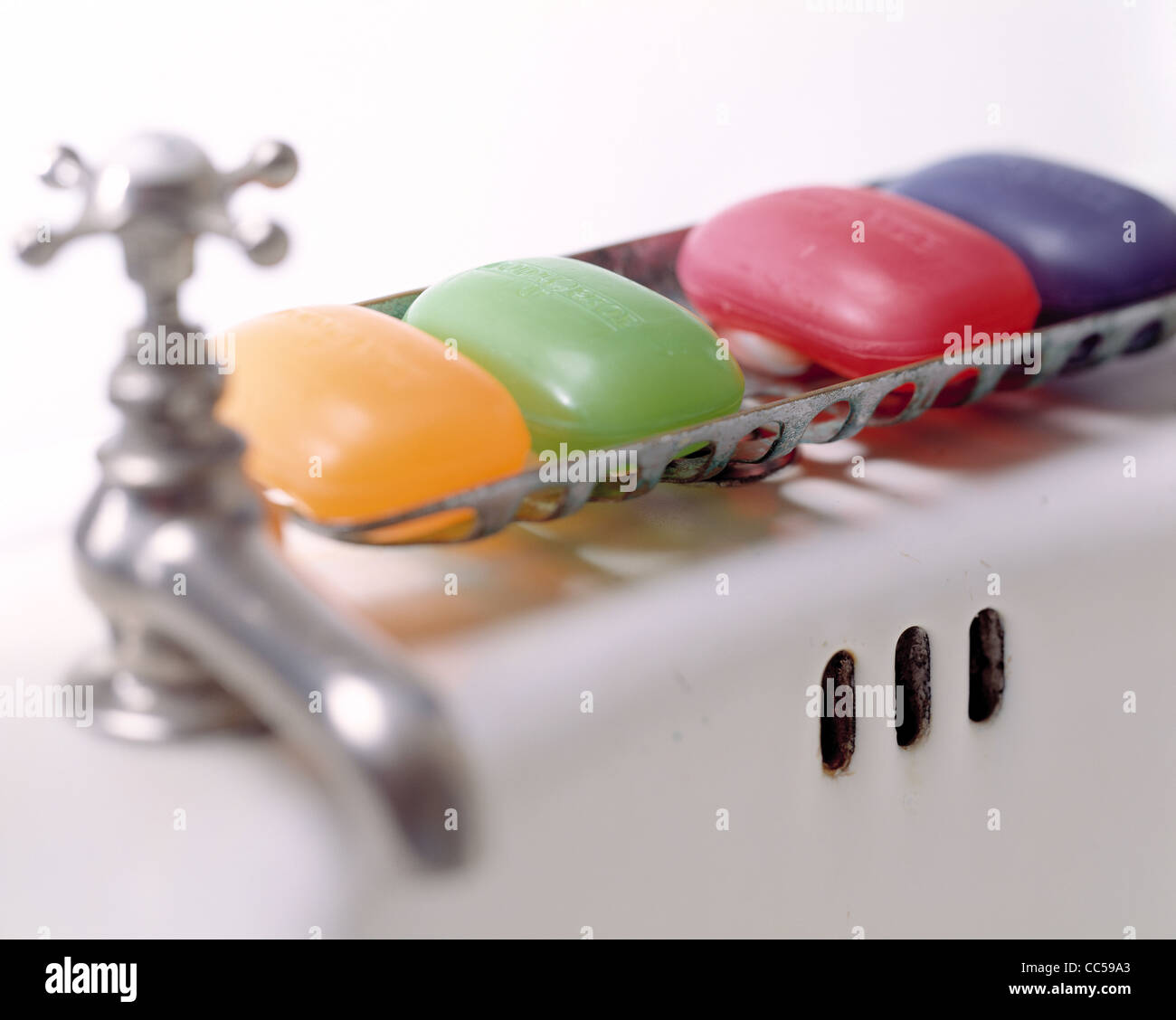 Rainbow of Glycerin Soaps and Faucet - Stock Image