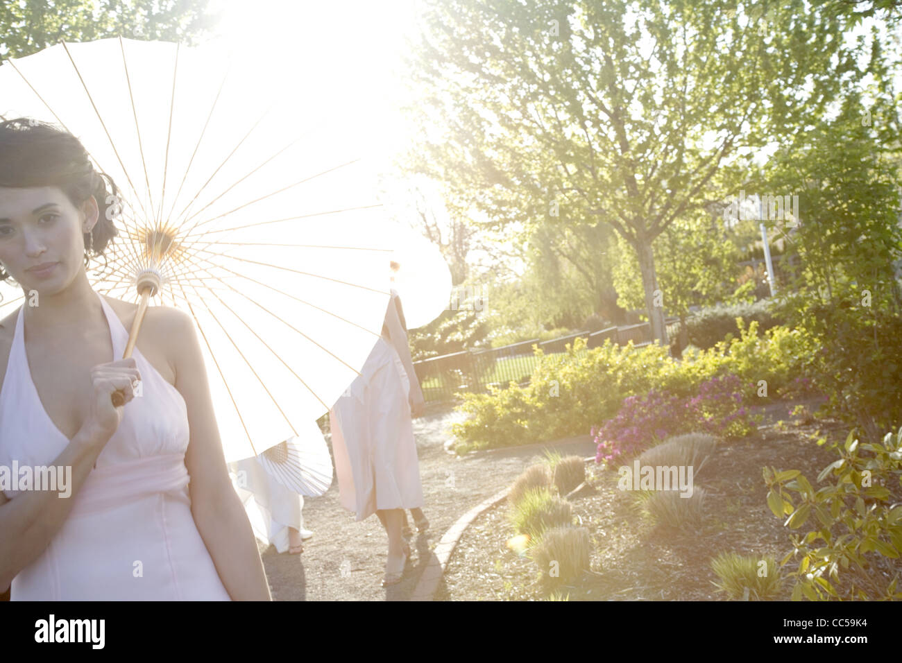 Woman in White with Paper Umbrella Stock Photo