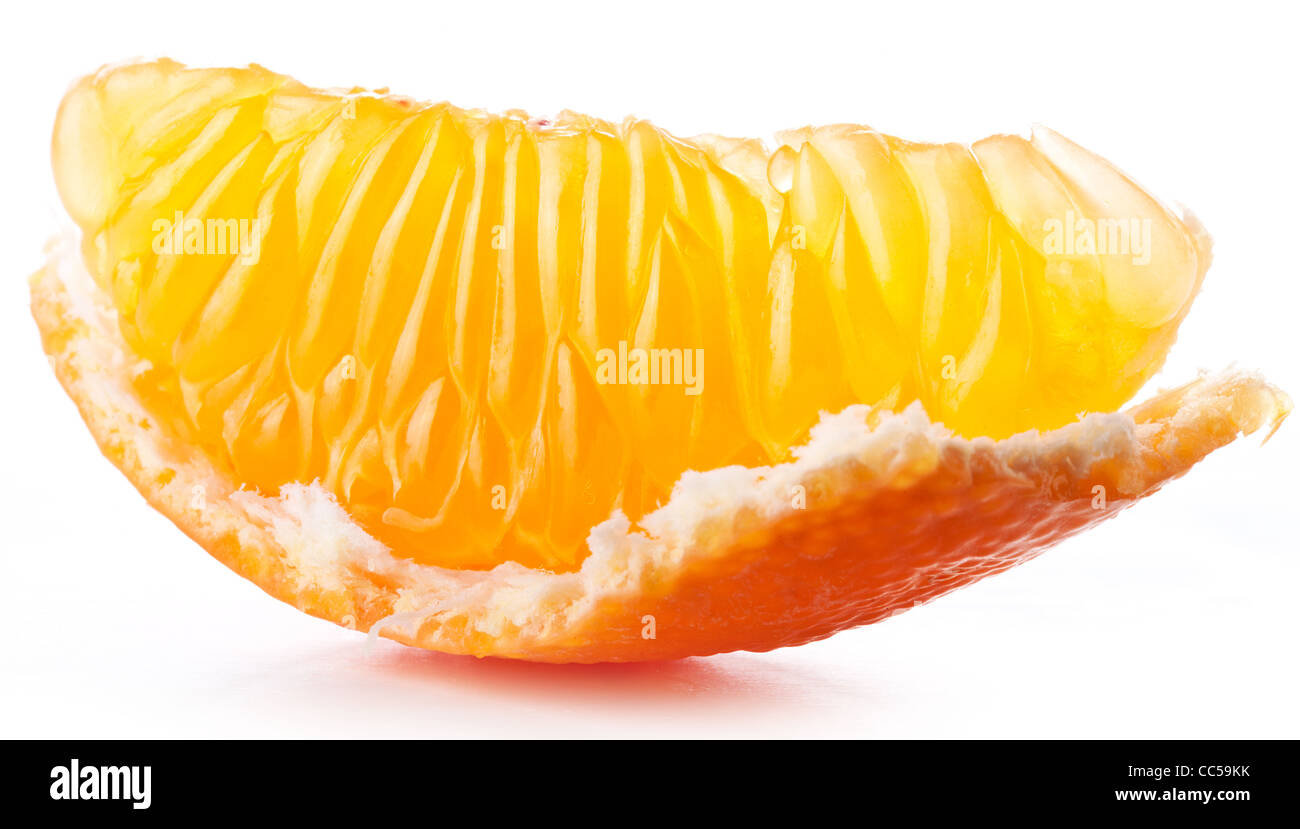 Tangerine slice on white background. - Stock Image