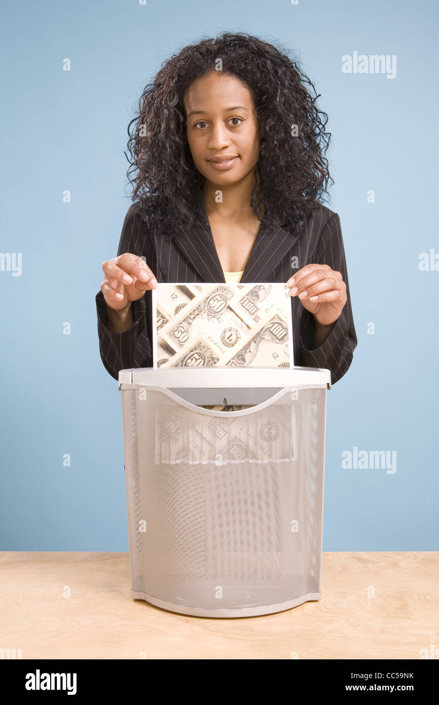 Black Executive Shredding Money in Effigy Stock Photo