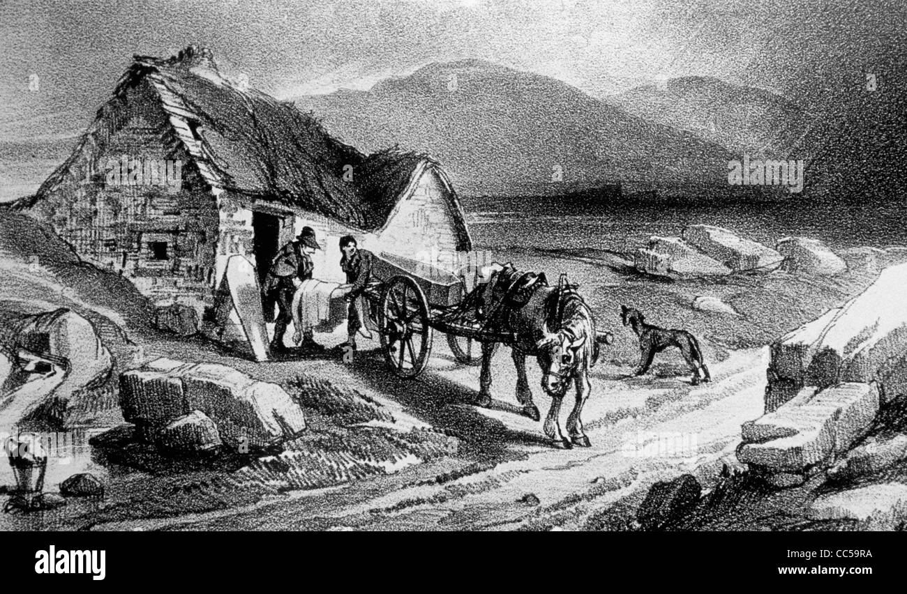The dead are removed from a thatched cottage during the Great Irish Famine of the 1840's - Stock Image