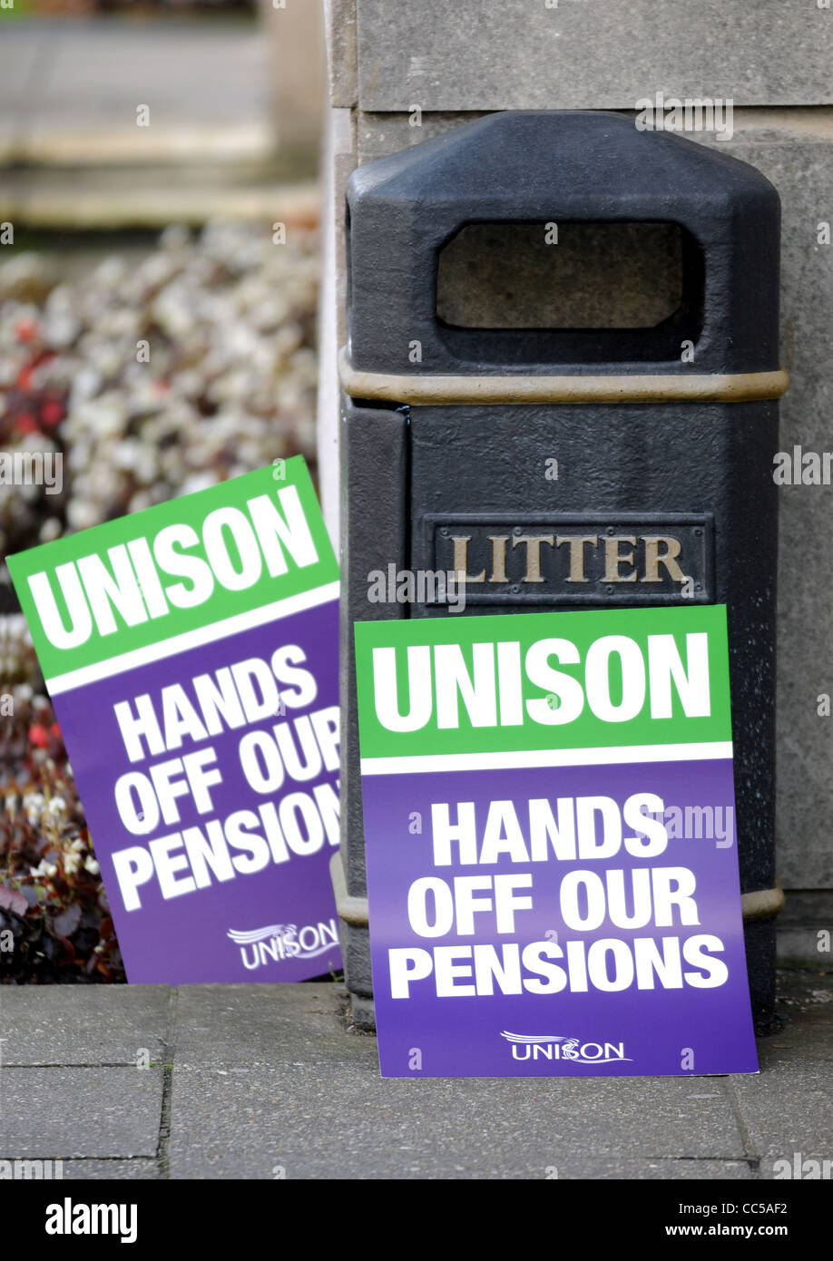 UNISON union placards by rubbish bin - Stock Image