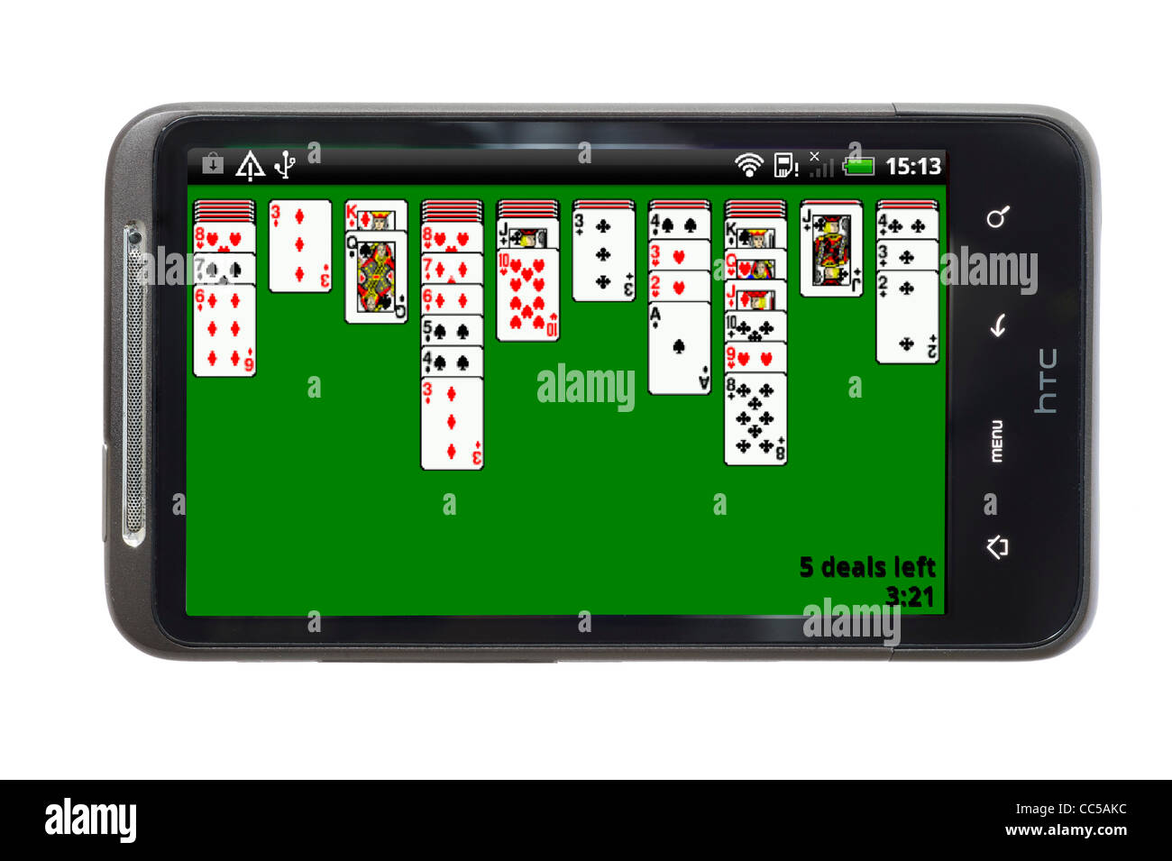 Playing Spider Solitaire on an HTC smartphone - Stock Image