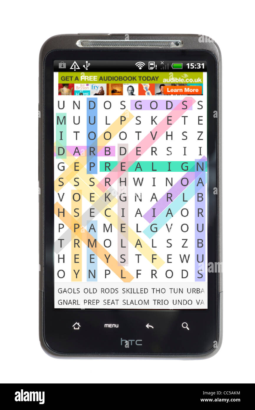 Playing Word Search on an HTC smartphone - Stock Image