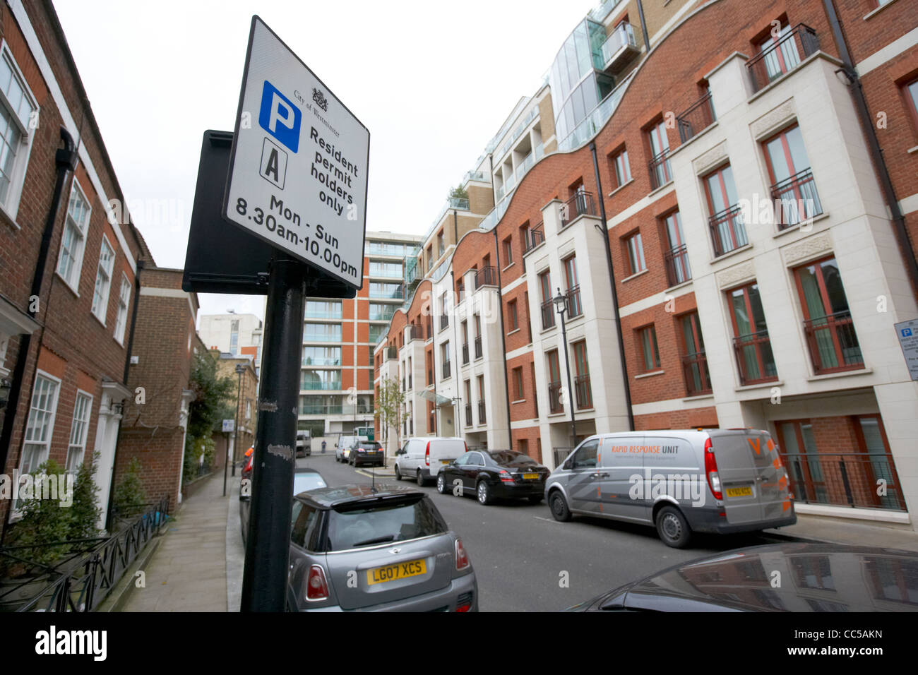 resident parking spaces in front of townhouses lancelot place knightsbridge London England UK United kingdom - Stock Image