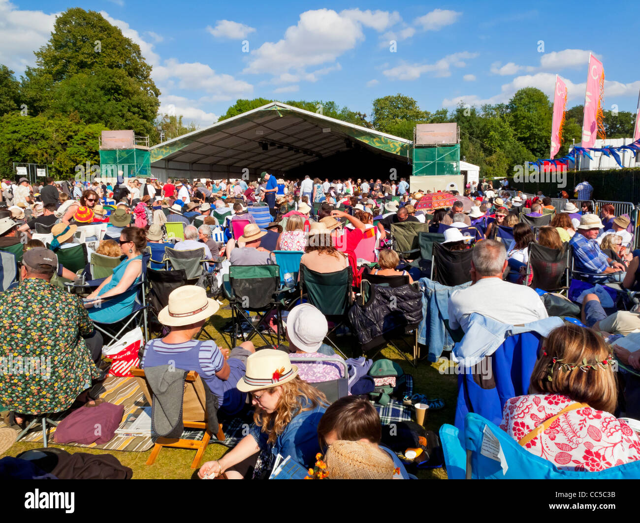 Crowd at the Cambridge Folk Festival held at the end of July each year at Cherry Hinton in the city of Cambridge - Stock Image