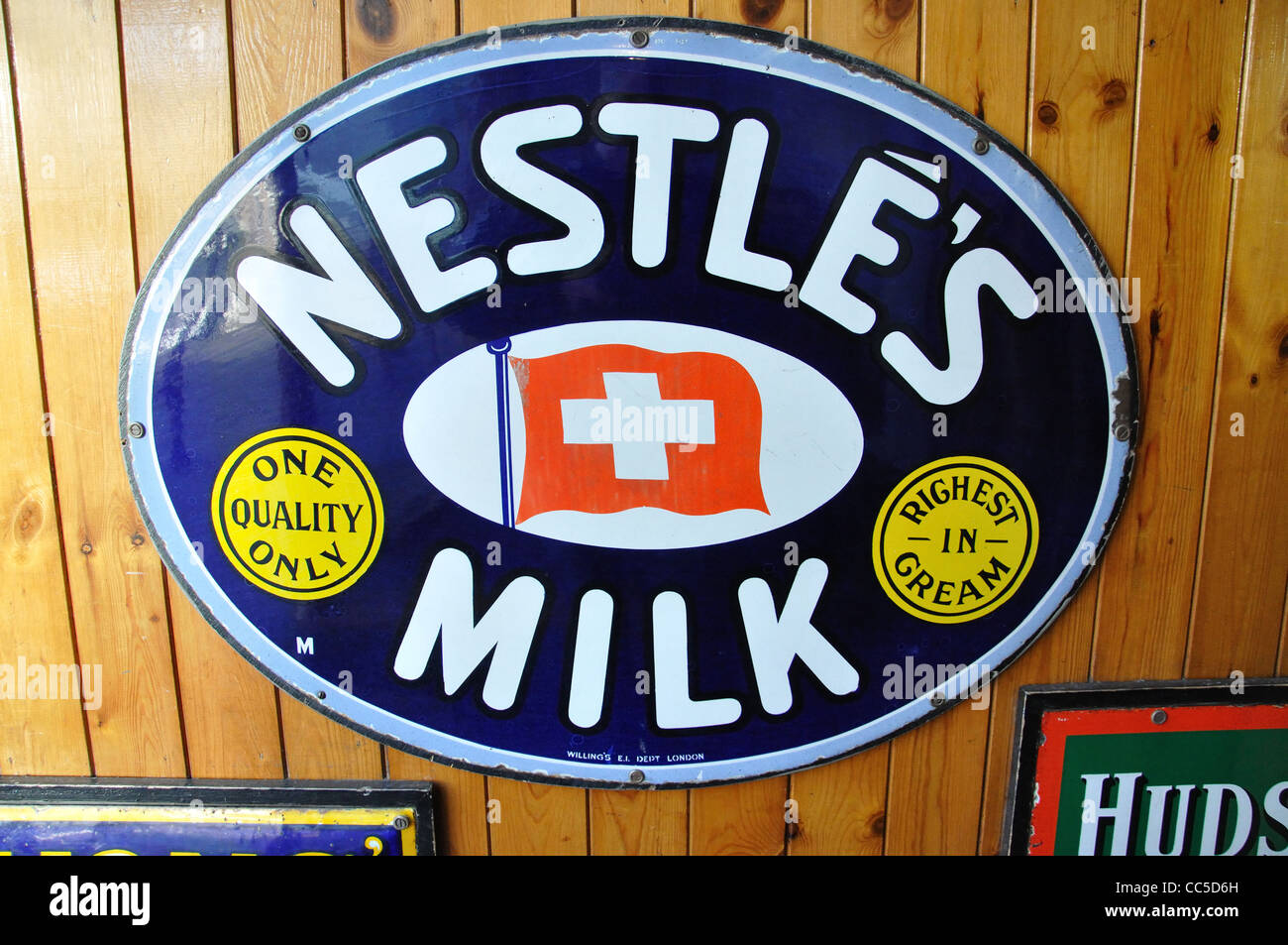 Nestle milk advert sign in Edwardian Town, Beamish, The North of England Open Air Museum, County Durham, England, - Stock Image