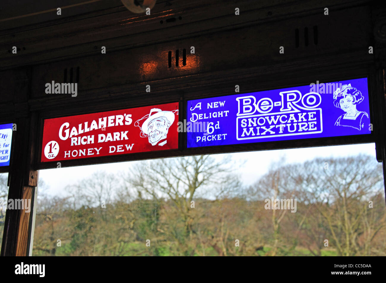 Glass adverts on tram in Beamish, The North of England Open Air Museum, near Stanley, County Durham, England, United - Stock Image