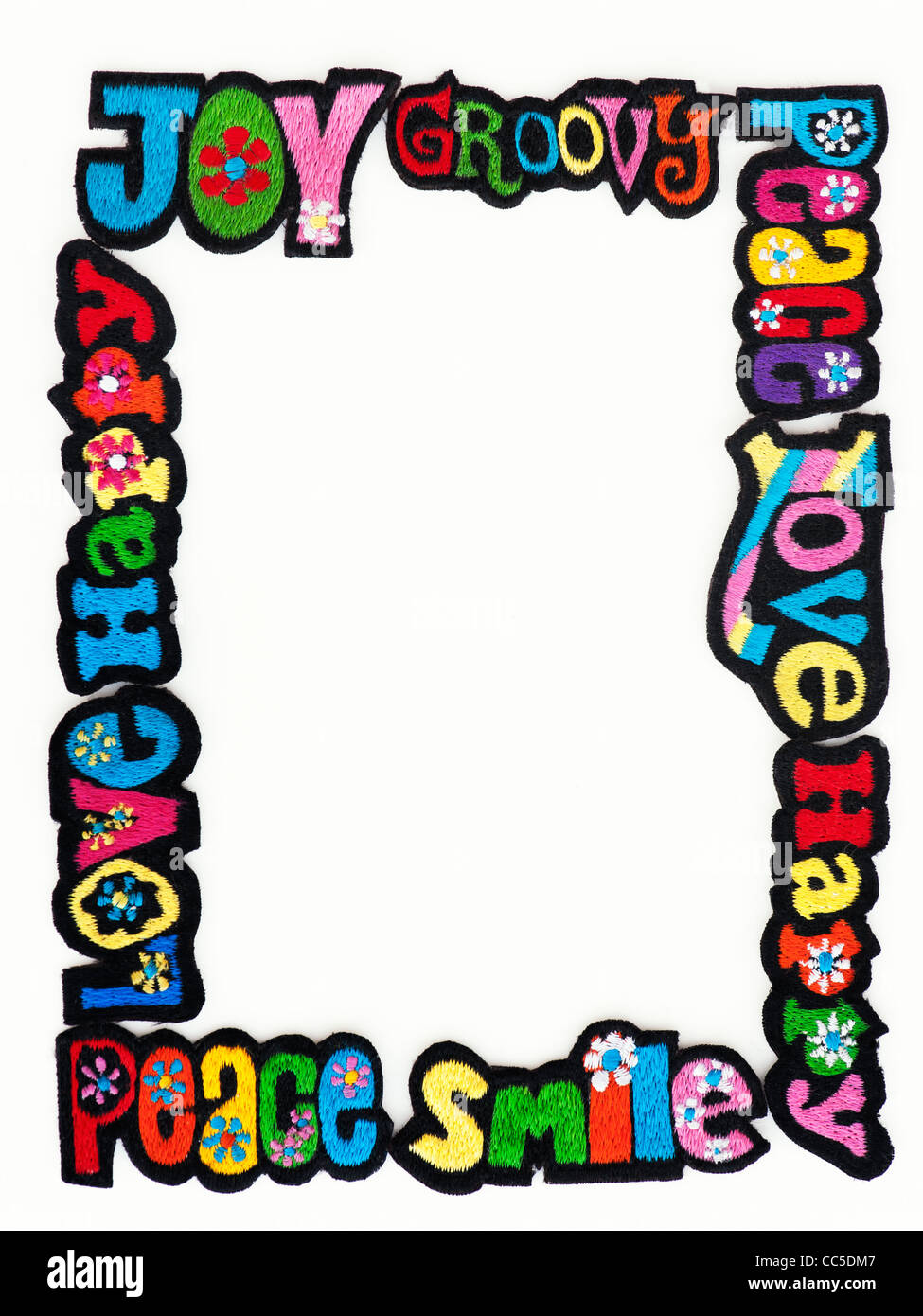 Embroidery iron on patches of Multicoloured Love, Peace, Happy, Smile and Joy words on a white background - Stock Image