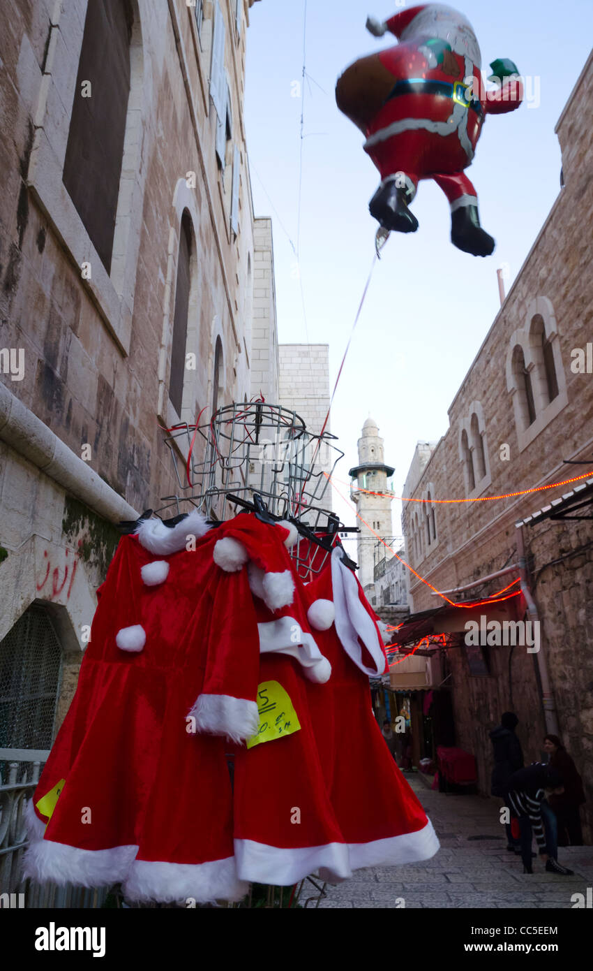 Santa Klaus balloon dummy and costumes in the streets of the Christian Quarter. Jerusalem Old City. Israel Stock Photo