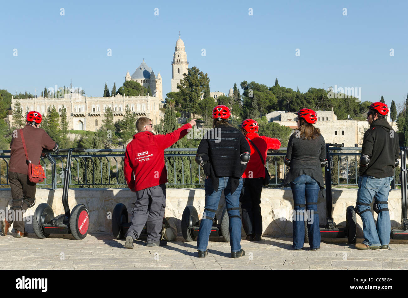 group of tourists with segways at viewpoint with dormition church in BKGD. Jerusalem. israel - Stock Image