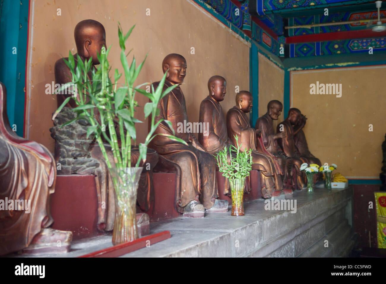 Disciple statues, Fa Yuan Temple, Beijing, China - Stock Image