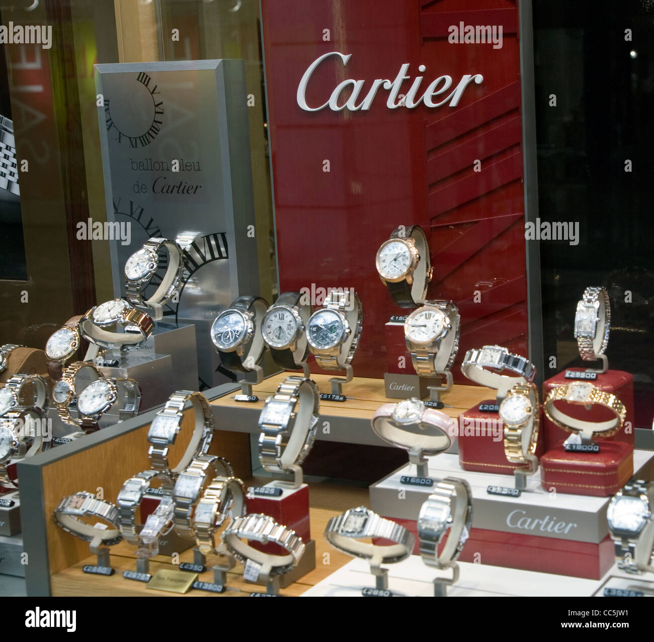photo display watches shop window stock cartier watch alamy
