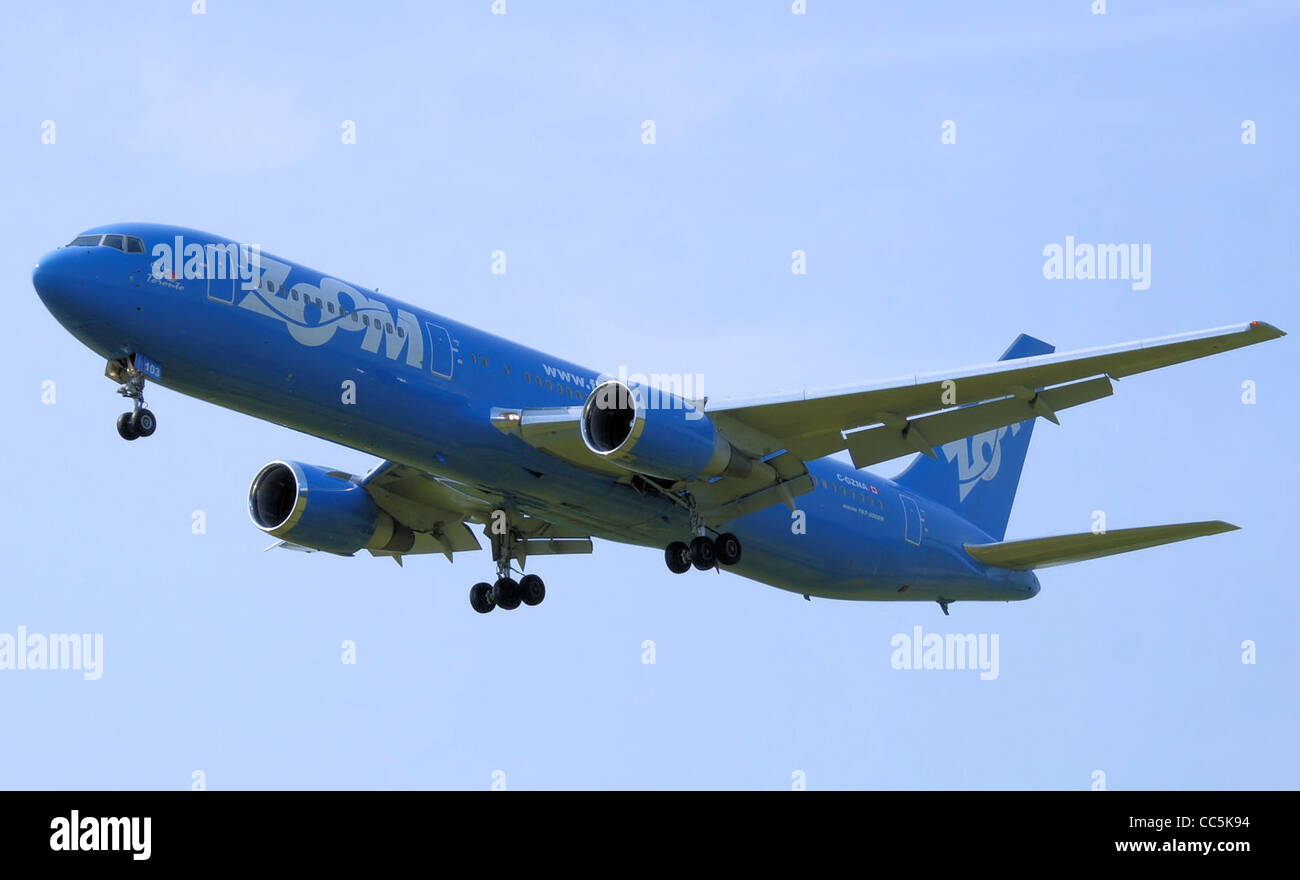 Zoom Airlines Boeing 767-300ER (C-GZNA) landing at London Gatwick Airport, England. - Stock Image